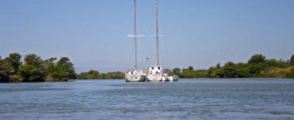 s_Sailboats anchored out near Liberty Island